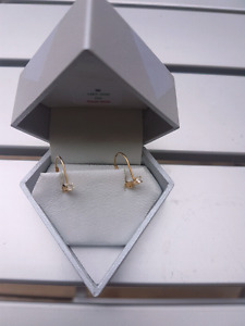 Ladies 14 karat gold diamond earrings