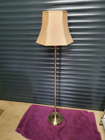 Tall solid brass floor standing lamp.