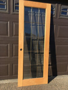 Oak door with beveled glass and brass trim