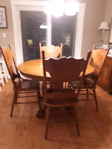 6 chairs, round table plus leaf, sideboard and hutch