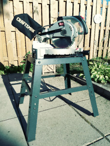 "10"" Craftsman compound miter saw with stand."