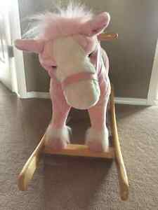 Pink rocking horse with sounds and head movement