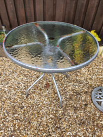 Two metal frame/glass top garden tables