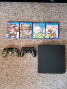 PlayStation 4 with controllers and games