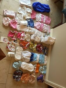 Lot of cloth diapers and training pants:  boys and girls