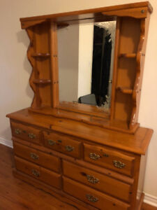 Solid wood dresser and matching mirror in good condition