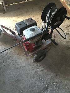 Pressure washer and reel