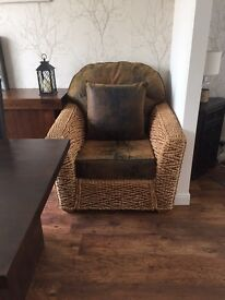 Conservatory wicker chair with leather worn effect cushions