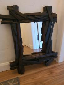 Dark brown wood mirror