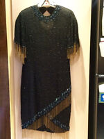 beautiful black sequence dress with gold beaded tassles