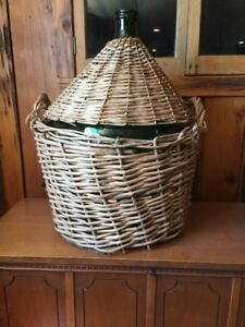Antique wicker basket and glass bottle