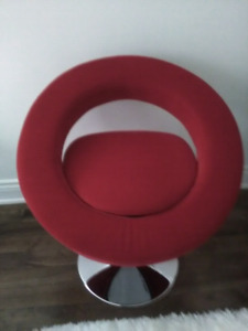 2 designer swivel chairs .  New condition.