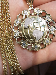 The world pendant and chain 10k solid gold