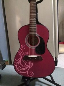 Pink acoustic guitar and stand