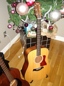 Acoustic Guitar by Taylor