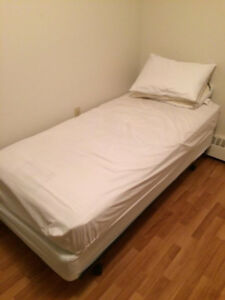 Brand new twin bed with covers