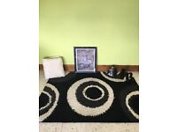 Black cream and grey rug , cushions ornaments