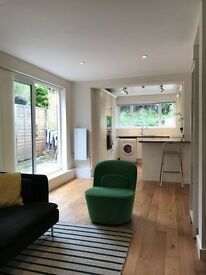 Double room in 2-bed West Hampstead garden flat with friendly female & dog