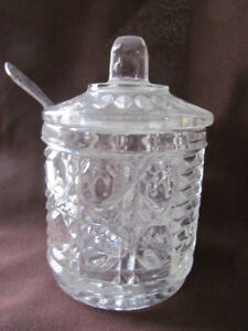 COVERED CUT-GLASS JAM JAR WITH SERVING SPOON.