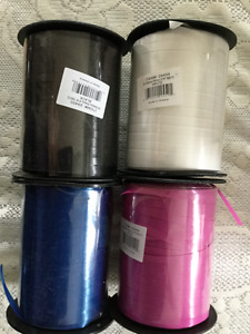 4 brand new rolls of curling/balloon ribbon