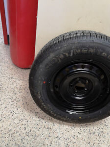 new 215-70-16  continental tire on spare rim