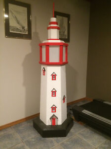 Backyard lit lighthouse