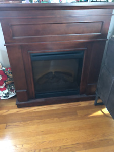 Electric wooden fireplace with wooden mantle