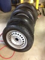 Set of Cooper Winterforce tires and steel rims for sale