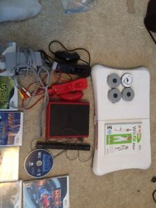 Wii Mini, Wii Fit, 23 games, remotes