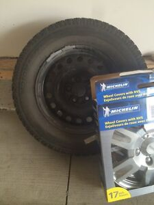 Motomaster total terrain winter tire with studs.