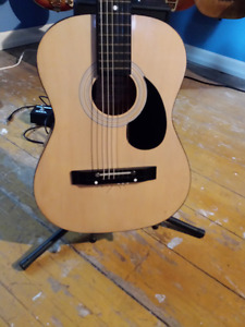 Harmony 01542-K parlor size classical acoustic guitar.