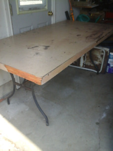Work bench with fold up legs
