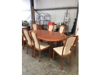 Extending Skovby dining table and 8 chairs