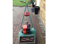 Qualcast Suffolk punch petrol lawn mower with grass collector