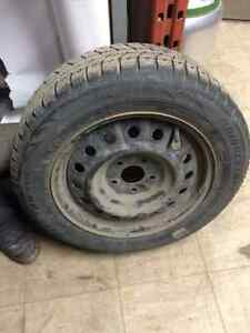 Winter tires with rims and hubcap