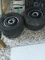215/65/R16 LIKE NEW STUDDED WINTER TIRES