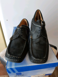 New. Casual, black leather shoe. SIZE 39/8.5