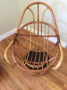 Two Swivel Rocking Rattan Chairs and a foot stool