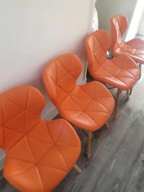 4 stunning orange chairs