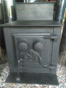 Wood stove with insulated chimney pipes.