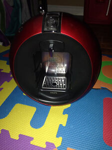 Catière à capsule Dolce Gusto rouge (20 $)