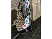 Portable strap on highchair seat