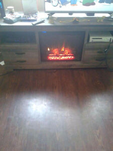 43 inch lg tv with huge wooden fireplaceLl perfect conditiont on