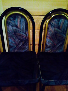 Black table with 4 chairs plus 2 bonus chairs
