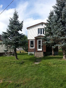 4 Bedroom Home with a detached garage is located in Larder Lk.