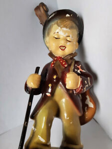 Vintage Chalkware Boy with Walking Stick and Cello on his Back
