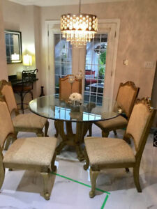 Glass round table with 5 chairs solid wood. 54 inches across.