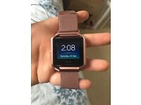 FitBit Blaze plum with extra rose gold strap