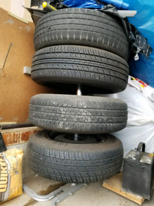 set of 4 all season tires and steel rims