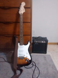Fender Strat guitar and 15w amp